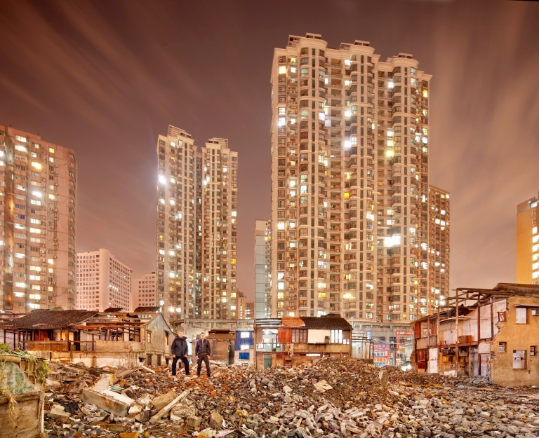 Photograph of the demolished remains of the Old City in Shanghai, China at night